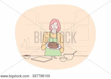 Cooking, Baking, Recipe Concept. Young Smiling Woman In Apron Holding Plate With Homemade Chocolate
