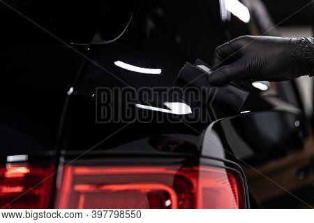 Car Detailing Studio Worker Applying Ceramic Coating