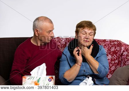 The Husband Is Caring For A Sick Elder Woman. An Elderly At Home With Angina.