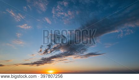 Fluffy Clouds In Evening Sunset Sky Panoramic View. Climate, Environment And Weather Concept Cloudsc