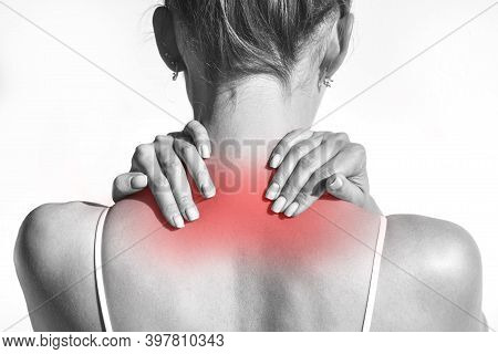 Closeup Shot Of Woman From Back With Neck Pain. Neck And Shoulder Pain And Injury Or Muscle Spasm. B