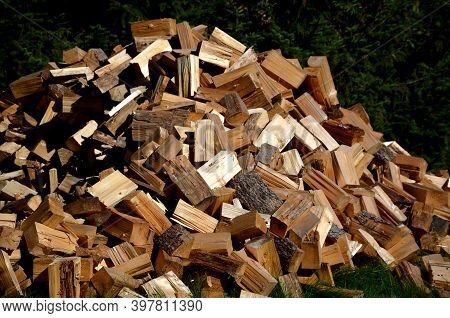 A Pile Of Chopped Wood For Heating In The Cottage, It Is Spruce And Pine Wood Chopped With An Ax Or