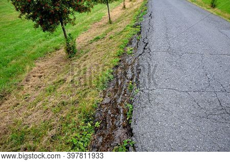 Dangerous Road Cracked And Torn By Frost And Poor Construction. To The Road Edge Which Can Break Off