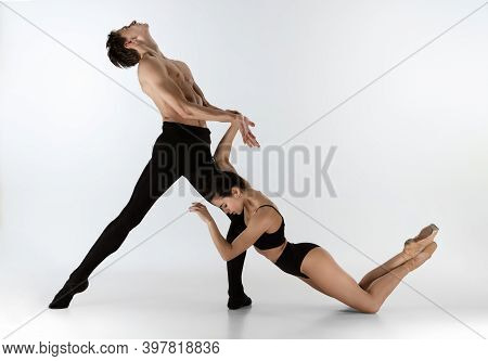 Relationship. Young And Graceful Ballet Dancers In Black Style Isolated On White Studio Background.