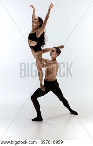 Flying. Young And Graceful Ballet Dancers In Black Style Isolated On White Studio Background. Art, F