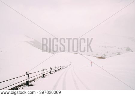 Snowy Empty Free Road In Winter Hills Mountains Landscape. Georgia, Eurasia. Drive And Trip, Travel