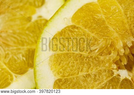 Close-up Of Pomelo Slices. Citrus Yellow Fruit. Textured Background From Pomelo.