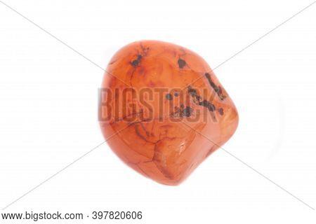 An Orange Carnelian Gemstone Shot Against A White Studio Background