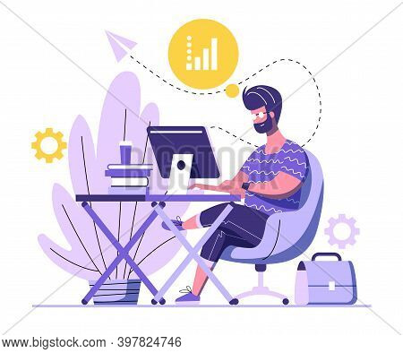 Handsome Man Is Working On Computer. A Man Is Sitting On An Armchair Behind The Office Desk With Boo