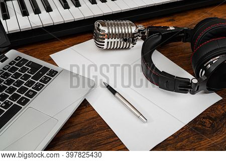 Music Studio Equipment And White Paper With Pen. Songwriting Concept.
