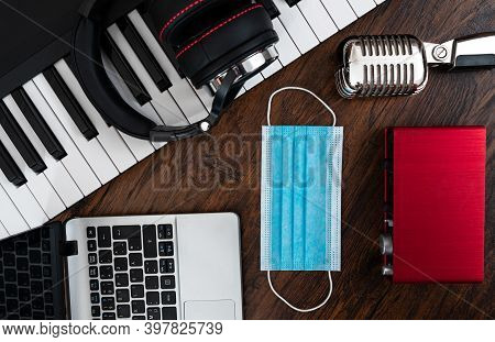 Music Studio Equipment And Medical Mask. Covid-19 Restrictions Concept.