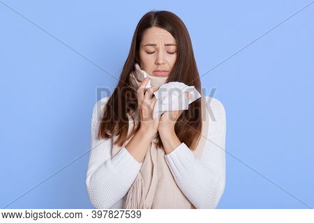People, Healthcare, Rhinitis, Cold And Allergy. Unhappy Woman With Paper Napkin Blowing Nose, Holdin