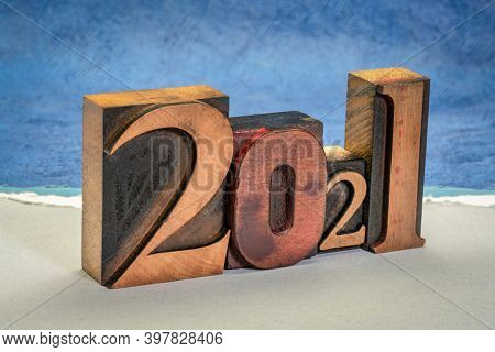 2021 year in vintage, gritty letterpress wood type against abstract paper landscape, New Year concept