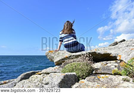 Woman On A Cliff Looking At The View At Famous Rias Baixas In Galicia Region, Spain.