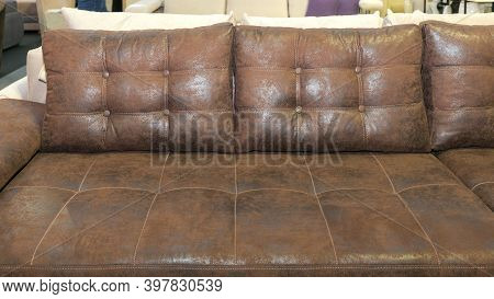 Faux Leather Sofa With Big Brown Backrest Pillows