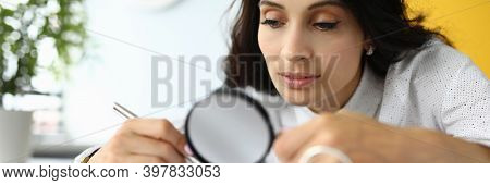Businessman Holds Magnifying Glass And Looks At Documents. Lawyer Services Concept