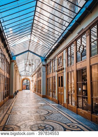PARIS, FRANCE - August 22, 2019: Covered Passage of Paris are an early form of shopping arcade built in Paris, France
