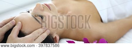 Portrait Of Woman Whose Master Does An Acupressure Face Massage. Efficiency Of Acupressure Face Mass
