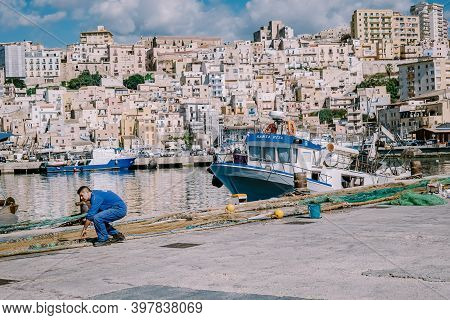 Sciacca Sicily October 2020, Fishing Boats And People Repair Nets At The Colorful City Of Sciacca Ov