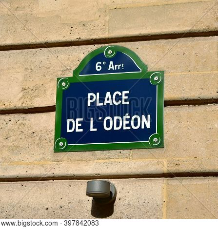 Place De L'odeon Street Sign Close-up. Paris, France. Text: 6th District. Square Of The Odeon.