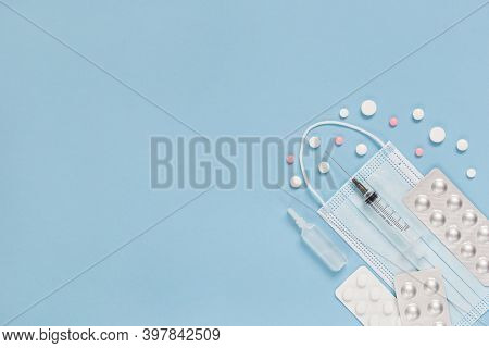 Medical Face Mask, Packaging With Pills, Ampulla And Expendable Syringe For Vaccination. Coronavirus