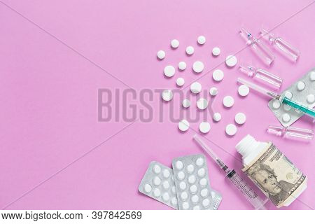 Medical Bootle With Dollars, Packaging With Pills, Ampullas And Expendable Syringes For Vaccination.