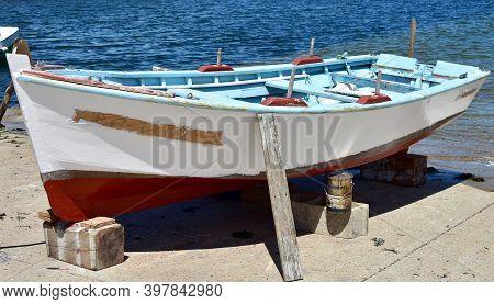 Portosin, Spain. July 5, 2020. Old Galician Wooden Rowboat In A Harbor. Coruña Province, Rias Baixas
