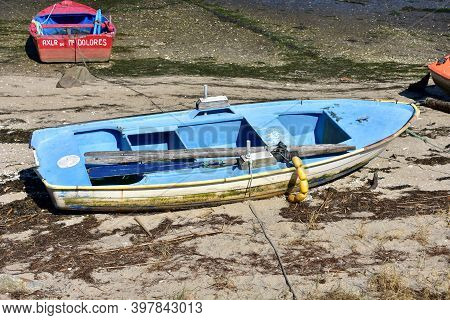 Portosin, Spain. September 11, 2020. Old Galician Wooden Rowboat In A Harbor. Coruña Province, Rias