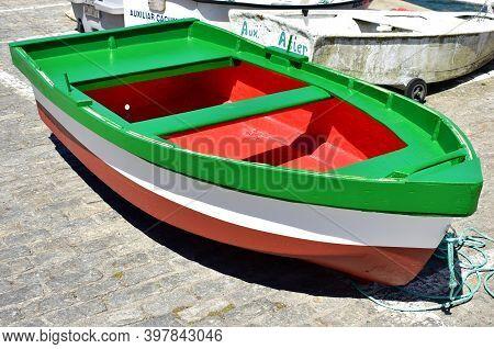 Corcubion, Spain. July 11, 2020. Colorful Galician Wooden Rowboat In A Harbor. Rias Baixas, Coruña P