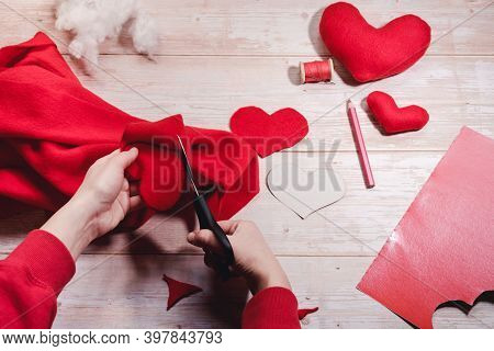 Step By Step Instruction. Diy Concept. Cut Out The Heart With Scissors From Red Fleece Fabric. Step