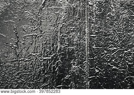 Abstract Old Lacquered Glossy Surface For A Textured Background Or Wallpaper In Black