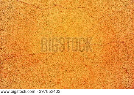 Old Plastered Wall Surface With Thin Cracks For Rough Textured Background Or Wallpaper Of Bright Ora