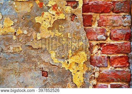 Abstract Part Of An Old Brick Wall With Destroyed Plaster For A Vintage Retro And Loft Style Backgro