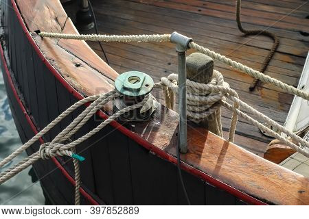 Detailed Close Up Detail Of Ropes And Cordage In The Rigging Of An Old Wooden Vintage Sailboat