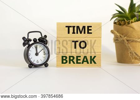 Time To Break. Wooden Blocks With Words 'time To Break'. White Table. Black Alarm Clock And House Pl