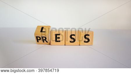 Having Less Press Or Being Press-less. The Word 'press' And 'less' On Wooden Cubes. Beautiful White