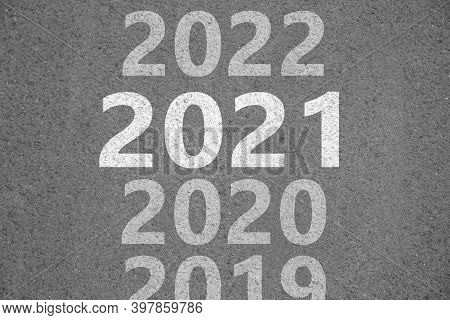 Start New Year With Fresh Vision And Ideas. 2021 Numbers Bigger Than Others On Asphalt Road