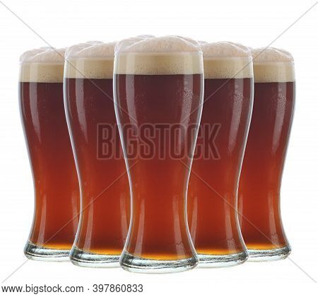 Various Kinds Of Draft Beer Glasses And Mugs On A White Background. Fresh Beer Brewed With Hops And
