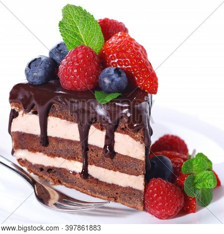 Layer The Chocolate Cake On A White Plate With Fresh Strawberry Lychee Fruit And Sauce. Homemade Bak