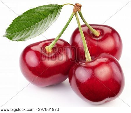 Three Ripe Cherries With Cherry Leaves Isolated On White Background. Fresh Food