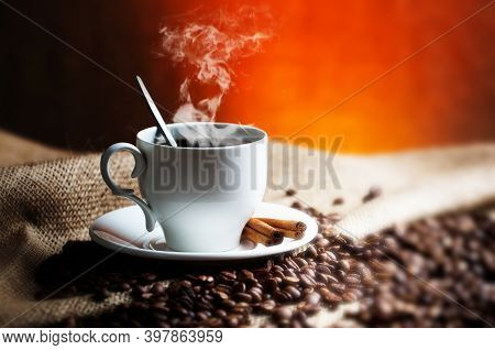 A Cup Of Coffee On A White Cup. Black Americano Coffee. Coffee Cup With Cinnamon. Coffe Lover