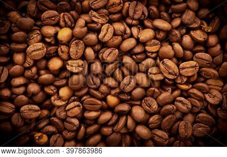 Delicious Coffee Beans. Texture Of Coffee Beans, Brown Roasted Coffee Beans. Close-up Shot Of Coffee
