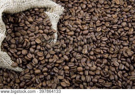 Texture Of Coffee Beans, Brown Roasted Coffee Beans. Close-up Shot Of Coffee Beans.