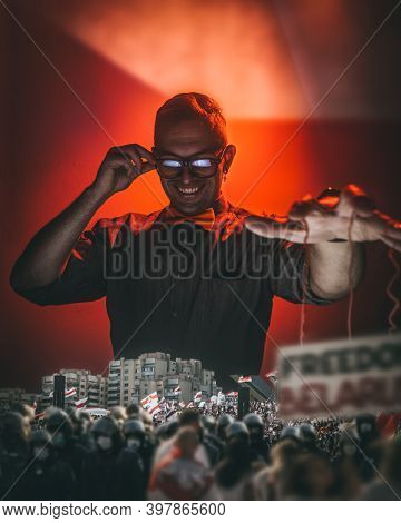 A Man Manipulates The Crowd With Strings, An Image Of Political Games