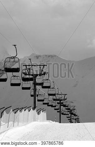 Black And White View On Snowy Skiing Piste And Ropeway. Caucasus Mountains. Georgia, Region Gudauri