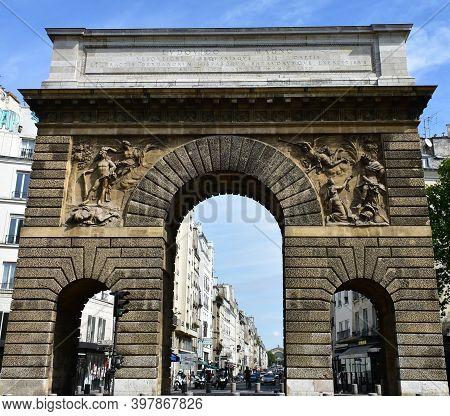 Paris, France. August 16, 2019. Porte Saint-martin, Triumphal Arch Erected By Louis Xiv On 1674 Clos