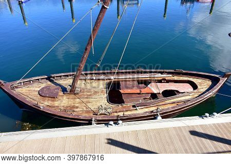 Old Traditional Wooden Sailing Boat In A Harbor. Muros, Rias Baixas, Coruña, Galicia, Spain.