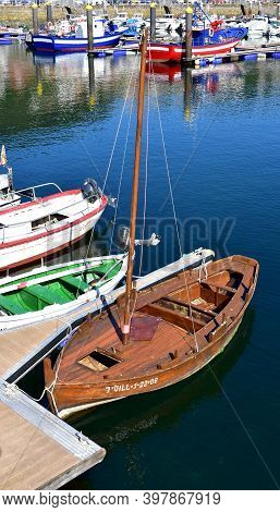 Muros, Spain. June 18, 2020. Old Wooden Galician Traditional Fishing Boats Moored In A Harbor. Rias