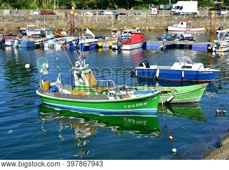 Porto Do Son, Spain. July 3, 2020. Old Wooden Galician Fishing Vessels Moored In A Harbor At Famous