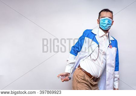 Portrait Of A Strange Doctor In A Protective Medical Mask, Which Coveres All His Face. Funny Doctor